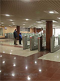 """Станция метро """"Митино"""" Балкон северного вестибюля. Турникеты по входу пассажиров на станцию."""